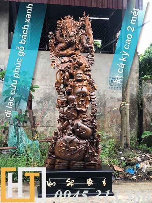 tượng di lặc cửu phúc gỗ bách xanh