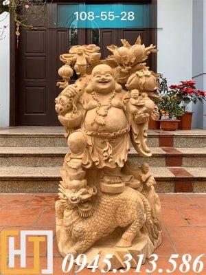 tượng phật di lặc đứng nghê vác cành đào gỗ xá xị nguyên khối